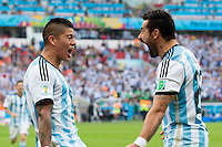 Marcos Rojo of Argentina celebrates scoring a goal with Ezequiel Lavezzi after making it 3-2
