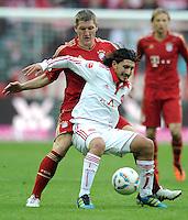 FUSSBALL   1. BUNDESLIGA  SAISON 2011/2012   11. Spieltag FC Bayern Muenchen - FC Nuernberg        29.10.2011 Bastian Schweinsteiger (li, FC Bayern Muenchen) gegen Almong Cohen (1 FC Nuernberg)