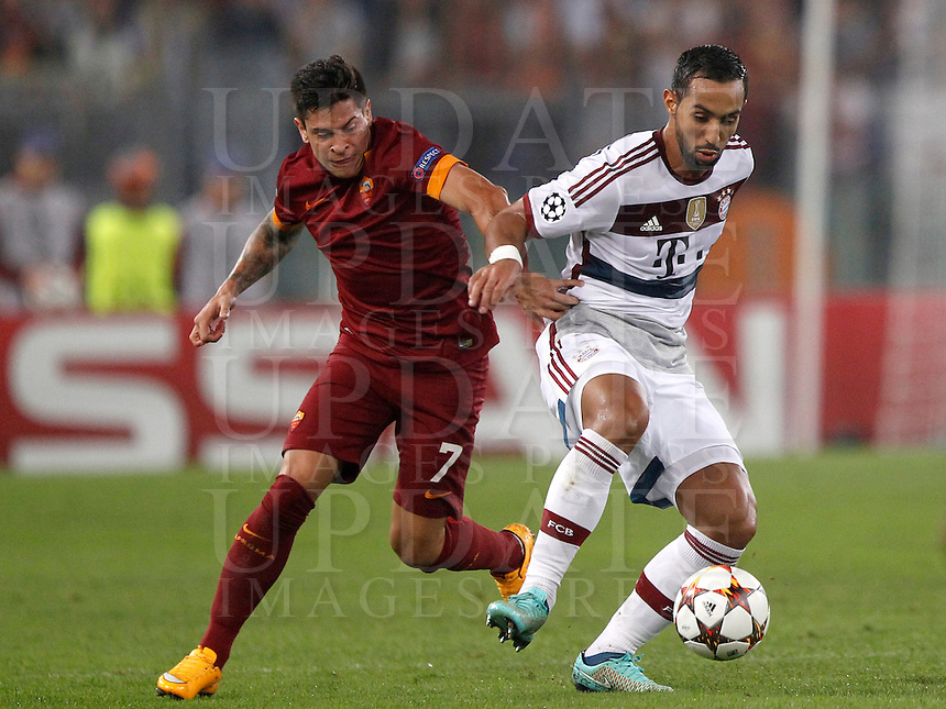 Calcio, Champions League, Gruppo E: Roma vs Bayern Monaco. Roma, stadio Olimpico, 21 ottobre 2014.<br /> Bayern&rsquo;s Mehdi Benatia is challenged by Roma&rsquo;s Juan Iturbe, left, during the Group E Champions League football match between AS Roma and Bayern at Rome's Olympic stadium, 21 October 2014.<br /> UPDATE IMAGES PRESS/Isabella Bonotto