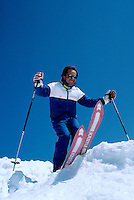Male Skier downhill skiing on Whistler Mountain, Whistler, BC, British Columbia, Canada (Model Released)