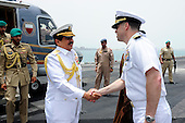 Arabian Sea - May 17, 2009 - Captain Ted R. Williams, executive officer of the aircraft carrier USS Dwight D. Eisenhower (CVN 69), welcomes the King of Bahrain, His Majesty the King Hamad bin Isa Al Khalifa, aboard Dwight D. Eisenhower Sunday, May 17, 2009 during an historic port visit to the Kingdom of Bahrain. Dwight D. Eisenhower is the first Nimitz-class aircraft carrier to dock at the newly-completed Khalifa bin Salman Port. The Eisenhower Carrier Strike Group is deployed to the U.S. 5th Fleet area of responsibility as part of a scheduled deployment supporting Operations Enduring Freedom and Iraqi Freedom as well as maritime security operations. .Credit: Bradley Evans - U.S. Navy via CNP
