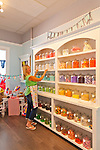 Proprietor Dana Hueberger re-stocking the candy shelves in her store, Sugar Sugar, in Salem, Oregon