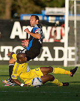 Emilio Renteria of the Crew battles for the ball against Ramiro Corrales of the Earthquakes during the first half of the game at Buck Shaw Stadium in Santa Clara, California.  San Jose Earthquakes tied Columbus Crew, 2-2.