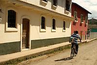 Boy riding a bicycle in the Spanish colonial town of Gracias, Lempira, Honduras...