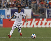Foxborough, Massachusetts - June 27, 2015:  In a Major League Soccer (MLS) match, Vancouver Whitecaps (white) defeated the New England Revolution (blue/white), 2-1, at Gillette Stadium.