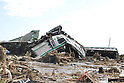 A Joban Line train near JR Shinichi Station, Fukushima Prefecture destroyed by the tsunami that struck after earthquakes devasted much of Japan's north east coast on Friday March 11th, 2011.