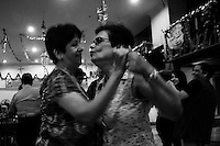 Two Anglo Indian ladies are jiving at Grail club during a pre chrstmas party. Grail club is an exclusive Anglo Indian club.