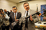 LAPD Chief Chalrie Beck holding an assault weapon that was turned in, LA Mayor Antonio Villaraigosa is standing next to him..Gun buy-back program in Los Angeles press conference at LAPD headquarters. LA Mayor Antonio Villaraigosa and LAPD Chief Charlie Beck announced that 1172 guns were turned in at 4 locations in Los Angeles. Gift cards are given in trade for the no-question buyback program. $200 for assault weapons and $100 for handguns. 1 pipe-bomb was also turned in, LAPD arrested the suspect who stated that god wanted him to turn in the bomb, and not to blow up the Hollywood sign anymore.