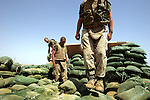 Marines with Kilo Co. 3rd Battalion 1st Marines (3/1) work to rebuild and improve an outpost in the desert outside of the al-Anbar Province city of Hit, Iraq on Sun. Sept. 18, 2005. 3/1 is replacing the outgoing battered Ohio-based reserve 3rd Battalion 25th Marines.