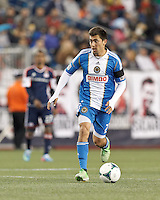 Philadelphia Union midfielder Michael Farfan (21) looks to pass.In a Major League Soccer (MLS) match, the New England Revolution (blue/red) defeated Philadelphia Union (blue/white), 2-0, at Gillette Stadium on April 27, 2013.