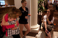 New York, NY - July 05, 2013 : Luke Spring, 10, hugs his mother Jill Spring in between classes with his sisters Lucy Spring, 18, center, and Cami Spring, 20, right, during the New York City Dance Alliance National Summer Workshop held at the Sheraton New York Times Square Hotel in New York, NY on  July 05, 2013. Luke Spring, a dance prodigy from Studio Bleu Dance Center in Ashburn, VA, has performed on the Tonys, Ellen, So You Think You Can Dance and The Ford Gala. His sisters Cami Spring, 20, and Lucy Spring, 18, are both award winning dancers. (Photo by Melanie Burford/Prime for The Washington Post)