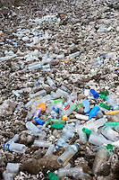Thousands of plastic bottles washed ashore on one of the North Male Atolls, Maldives (Wednesday, June 17th, 2009). Photo: joliphotos.com