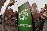 A gentleman wearing a sandwich board advertises H&R Block tax preparation services in Chelsea in New York on Thursday, March 21, 2013.  (© Frances M. Roberts)