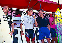 Sunny Garcia (HAW), Kelly Slater (USA)  and Ross Williams (HAW) are interviewed on stage by 'Surfer Joe' before paddling out in the 1994 Chiemsee Pipeline Masters. Slater won the event and also claimed the 1994 World Surfing Title. Photo: www.joliphotos.com