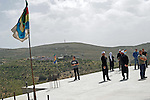 Standing on a rooftop overlooking Syria, Druze men during a pro-Syrian demonstration on the Syrian independence day, in Majdal Shams, Golan Heights, on Israel-Syria border.