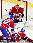 26 October 2009: Montreal Canadiens' goaltender Jaroslav Halak juggles the puck to make a second period save against left wing forward Matt Moulson of the New York Islanders at the Bell Centre in Montreal, Quebec, Canada. The Canadiens defeated the Islanders 3-2 in sudden death overtime for their 4th consecutive win. Mandatory Credit: Ed Wolfstein Photo
