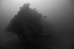 Grand Bahama Island, The Bahamas; the bow of Theo's Wreck emerges from the deep blue, resting on it's port side this two hundred and thirty foot freighter, was intentionally cleaned and scuttled by Theo Galanopoulos in 1982 and sits in 100 feet of water