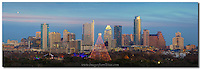 Looking over the Austin skyline in mid-December, you have a great view of the annual Trail of Lights and the Zilker Park Christmas tree. Behind the festivities rise the Austin icons - the Frost Bank Tower and the Austonian. The sky is dimly lit in pastels by the setting sun in the west.