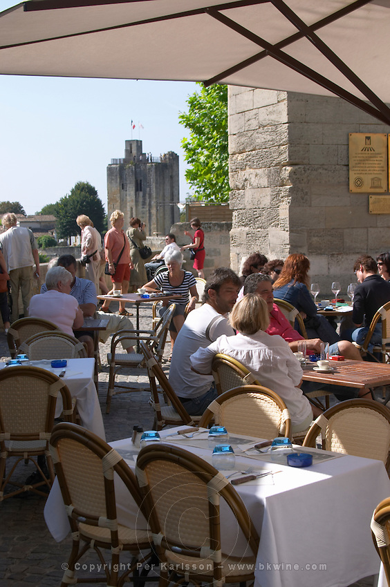 A cafe with a view over the Tour du Roy. The town. Saint Emilion, Bordeaux, France