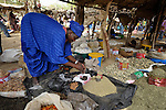 A woman lays out her products to sell in the market in Toya, a village in northern Mali near Timbuktu. The region was seized by Islamist fighters in 2012 and then liberated by French and Malian soldiers in early 2013.