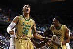 13 March 2015: Notre Dame's Zach Auguste (30) reacts to a play by Jerian Grant (22) who is helped up by Bonzie Colson (35). The Notre Dame Fighting Irish played the Duke University Blue Devils in an NCAA Division I Men's basketball game at the Greensboro Coliseum in Greensboro, North Carolina in the ACC Men's Basketball Tournament semifinal game. Notre Dame won the game 74-64.