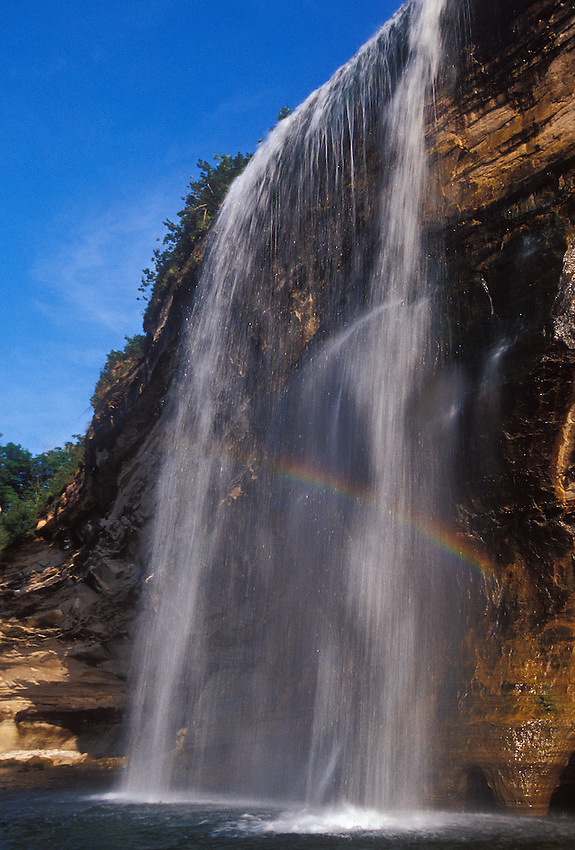 A rainbow is seen in Spray Falls as it cascades over a cliff into Lake Superior in Pictured Rocks National Lakeshore near Grand Marais, Mich.