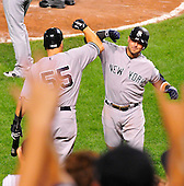 New York Yankees right fielder Nick Swisher (33) is congratulated by catcher Russell Martin (55) after he homered in the sixth inning against the Baltimore Orioles at Oriole Park at Camden Yards in Baltimore, Maryland in the second game of a doubleheader on Sunday, August 28, 2011.  The Yankees won the game 8 - 3, earning a split in the two games..Credit: Ron Sachs / CNP.(RESTRICTION: NO New York or New Jersey Newspapers or newspapers within a 75 mile radius of New York City)