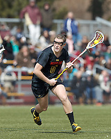 University of Maryland midfielder Kelly McPartland (6) on the attack. .University of Maryland (black) defeated Boston College (white), 13-5, on the Newton Campus Lacrosse Field at Boston College, on March 16, 2013.