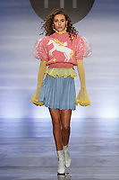 Model walks runway in an outfit by Enoch Park, during the Future of Fashion 2017 runway show at the Fashion Institute of Technology on May 8, 2017.