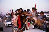 Punjab, Pakistan<br /> November 13, 1988<br /> <br /> Crowds greet Benazir Bhutto as she campaigns in the Punjab province.<br /> <br /> Benazir Bhutto is the eldest child of former Pakistan President and Prime Minister Zulfikar Ali Bhutto. She found herself placed under house arrest in the wake of her father's imprisonment and subsequent execution in 1979. In 1984 she became the leader in exile of the Pakistan Peoples Party (PPP), her father's party, though she was unable to make her political presence felt in Pakistan until after the death of General Muhammad Zia-ul-Haq. <br /> <br /> On 16 November 1988 Benazir's PPP won the largest bloc of seats in the National Assembly. Bhutto was sworn in as Prime Minister in December, at age 35 she became the first woman to head the government of a Muslim-majority state in modern times. <br /> <br /> She was removed from office 20 months later under orders of then-president Ghulam Ishaq Khan for alleged corruption. Bhutto was re-elected in 1993 but was again removed by President Farooq Leghari in 1996, on similar charges. Bhutto went into self-imposed exile in Dubai in 1998, until she returned to Pakistan on October 2007, after General Musharraf granted her amnesty and all corruption charges withdrawn.