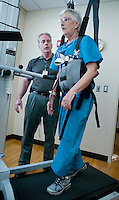 Dr. Paul Blake coaches stroke patient Mary Cogburn, 73,  of Mesa, as she uses the Lite Gait device to do some treadmill rehab at Banner Baywood Medical Center. Blake says that rehab is an integral part of recovery from a stroke, involving time in the rehab unit as well as additional after the patient is released from the hospital.