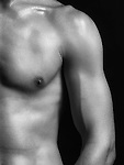 Young fit nude man body parts closeup of arm black and white