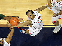 CHARLOTTESVILLE, VA- JANUARY 7: Mike Scott #23 of the Virginia Cavaliers reaches for a rebound during the game against the Miami Hurricanes on January 7, 2012 at the John Paul Jones Arena in Charlottesville, Virginia. Virginia defeated Miami 52-51. (Photo by Andrew Shurtleff/Getty Images) *** Local Caption *** Mike Scott