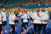 Team GB Hockey Team win gold at Rio Olympics. Team GB dance with their medals as their Netherlands rivals leave with silver and their supporters empty their seats in the background. <br /> Rio de Janeiro, Brazil on August 19, 2016.<br /> CAP/CAM<br /> &copy;Andre Camara/Capital Pictures /MediaPunch ***NORTH AND SOUTH AMERICAS ONLY***