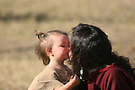 A Native American Indian mother kissing her daughter