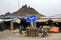 As the Convoy of fuel trucks heads out they pass the sign indicating the way to Tarin Kot