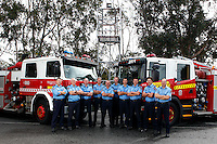 Daglish Fire & Rescue team with their new truck and the old truck of 20 years.