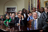 Washington, DC - March 24, 2009) -- United States President Barack Obama is joined by members of Congress and school children as he talks March 24, 2009, with astronauts on the International Space Station from the Roosevelt Room at the White House. Others seated include U.S. Senator Kay Bailey Hutchison (Republican of Texas), left; John Holdren, second left, Director of the Office of Science and Technology Policy; and U.S. Senator Bill Nelson (Democrat of Florida), right, who flew aboard the space shuttle in 1986. .Credit: Pete Souza - White House and NASA via CNP