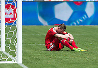 29 June 2013: Toronto FC defender Steven Caldwell #13 sits dejected after Toronto FC lost to Real Salt Lake during an MLS game between Real Salt Lake and Toronto FC at BMO Field in Toronto, Ontario Canada.<br /> Real Salt Lake won 1-0.