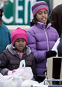 Chicago, IL - November 26, 2008 -- Sasha, left, and Malia Obama, daughters of President-elect  Barack Obama, pass out food to people at St. Columbanus Parrish and School Wednesday, November 26, 2008, in Chicago, Illinois. .Credit: Frank Polich - Pool via CNP