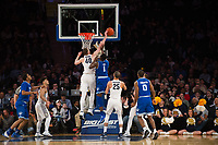 NEW YORK, NY - Thursday March 9, 2017: Luke Fischer (#40) of Marquette blocks a shot from Michael Nzei (#1) of Seton Hall as the two schools square off in the Quarterfinals of the Big East Tournament at Madison Square Garden.