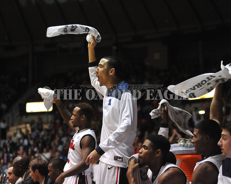 "Ole Miss' Anthony Perez (13) and Ole Miss' Derrick Millinghaus (3) cheer vs. Missouri at the C.M. ""Tad"" Smith Coliseum on Saturday, January 12, 2013. Ole Miss defeated #10 ranked Missouri 64-49."