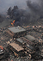 March 14, 2011: Smoke still rising from the severely damaged city even after 2 days from the earthquake, at 4:58PM in Otsuchicho, Iwate prefecture. Photographed by  Takeshi Noda from the company helicopter. (Photo by Mainichi Newspaper / Aflo)
