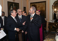 "HAVANA, CUBA: April 4, 2005.- Former Cuban President Fidel Castro talk whit his brother Raul Castro, after signed the ""Book of Condolences"" at the headquarters of the Catholic Nunciature in Havana for the death of Pope John Paul II. The Cuban Cardinal Jaime Ortega, who with Pope Francisco helped the restoration of relations between Cuba and the United States. Ortega will leave the leadership of the Catholic Church on the island, said Vatican. . Credit: Jorge Rey/MediaPunch"