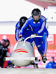 18 December 2010: Alexandr Zubkov starts up his 2-man bobsled for Russia, winning silver at the Viessmann FIBT World Cup Bobsled Championships on Mount Van Hoevenberg in Lake Placid, New York, USA. Mandatory Credit: Ed Wolfstein Photo