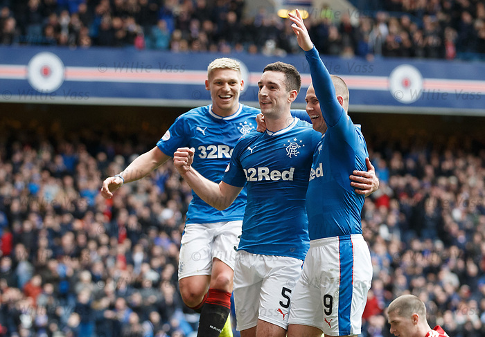 Lee Wallace scores the fourth goal for Rangers and celebrates with Kenny Miller and Martyn Waghorn