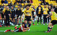 Dan Carter tackles Ma'a Nonu during the Super Rugby match between the Hurricanes and Crusaders at Westpac Stadium, Wellington, New Zealand on Saturday, 2 May 2015. Photo: Dave Lintott / lintottphoto.co.nz