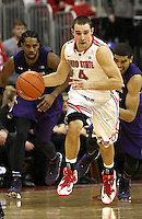 Ohio State Buckeyes guard Aaron Craft (4) returns the ball in the second half of their game against the Northwestern Wildcats at the Value City Arena in Columbus, Ohio on February 19, 2014. (Columbus Dispatch photo by Brooke LaValley)
