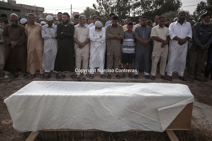 Thursday 19, May 2016: Family members, relatives and friends of Ali, an 18 years-old youth killed in a terrorist attack carried out by IS (Islamic State) in Abu Grain, gather during his funeral in a graveyard in Misrata City. Ali survived the attack and was taken to a military hospital in Italy, but he died by his injuries later on.