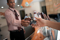 Customers browse for mobile phones in LG's Digitech showroom in central Khartoum.